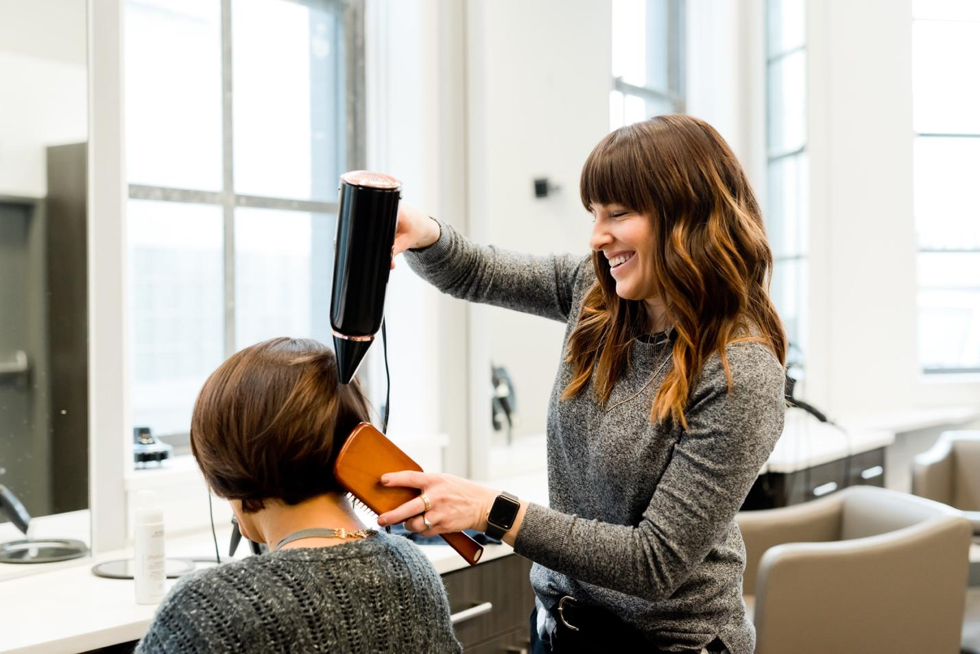A hairstylist with a client