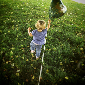 Amber chasing balloon  by Craig Payne - Babies & Children Toddlers ( park, grass, sunny, balloon, toddler,  )