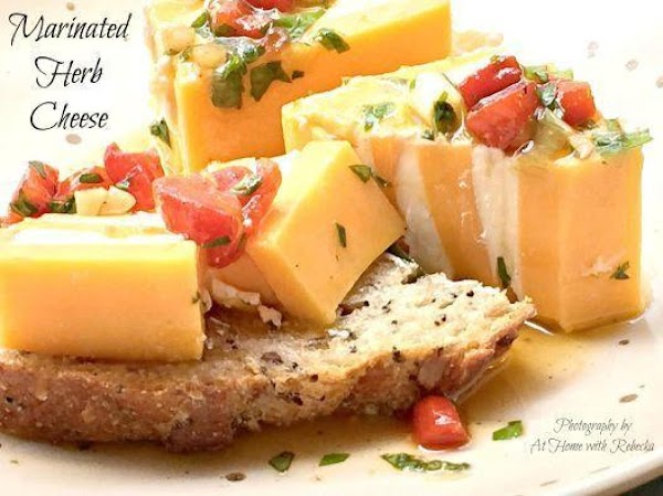 Pour marinade over arranged cheese, cover and refrigerate overnight. There will be a lot of...