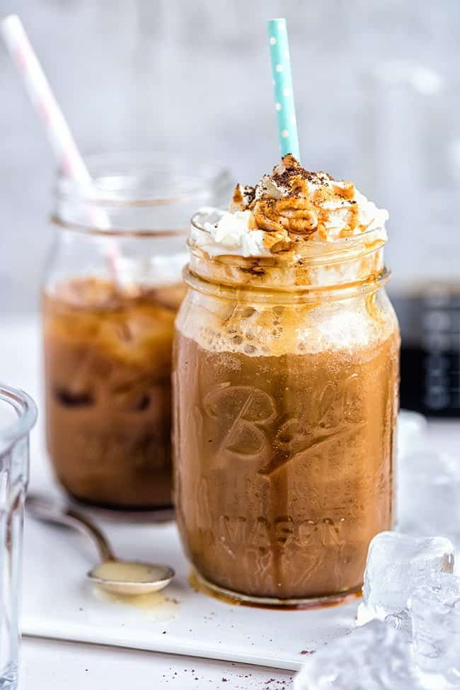 Iced coffee with whipped cream served in a Ball jar