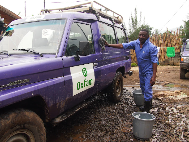 Photo: In Mweso Oxfam driver Alphonse Muhindo cleans his vehicleAlphonse Muhindo, cleans his Oxfam vehicle in Mweso, Democratic Republic of Congo.  Years of conflict in eastern DRC have created one of the world's largest and most complex humanitarian crises. Since 1998, an estimated 5.4 million people have lost their lives, and more than 1.7 million people remain displaced from their homes. Our emergency work focuses on the provision of clean water and sanitation and the promotion of safe hygiene practices.  Ultimately Oxfam believes that better governance in the Congo could greatly alleviate poverty. We work closely with teachers' unions and farmers' associations to help them hold their Government accountable. Photo: Caroline Gluck/Oxfam