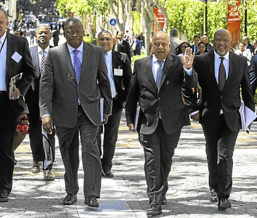 D-day: Finance Minister Pravin Gordhan, flanked by Treasury director-general Lungisa Fuzile, left, and Deputy Finance Minister Mcebisi Jonas, arrives to present the budget in 2016. Picture: BUSINESS DAY