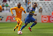 Kaizer Chiefs' star forward Khama Billiat (L) pulls away from Teko Modise of Cape Town City during the Absa Premiership at Cape Town Stadium, Cape Town, September 15 2018.
