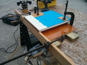 Photo: Next I altered the jig to allow for removing excess teak from the vertical face of the trim.
