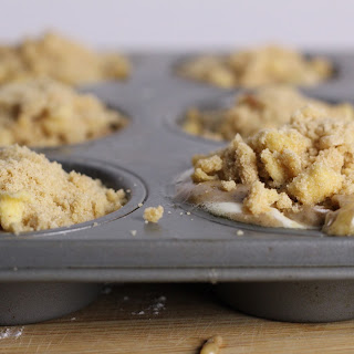 Irresistible Banana Cheesecake Swirl Muffins with Crumb Topping