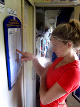 Photo: Liz tries to decode the schedule to figure out when to get off the train at Kamislov (there's no bell, electronic display, or announcement!)