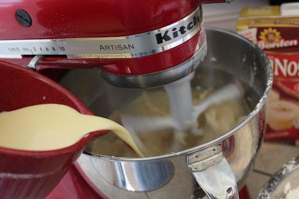 Alternate the flour and eggnog.