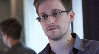 Photo: HONG KONG - 2013: In this handout photo provided by The Guardian, Edward Snowden speaks during an interview in Hong Kong. Snowden, a 29-year-old former technical assistant for the CIA, revealed details of top-secret surveillance conducted by the United States' National Security Agency regarding telecom data.  (Photo by The Guardian via Getty Images)