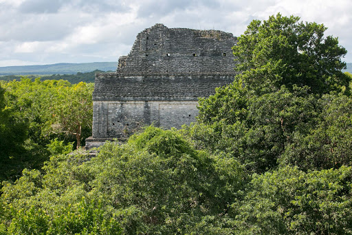 The ruins of a tall pyramid still rise through the rainforest at Dzibanche in Mexico's Costa Maya region.