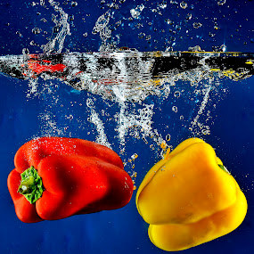 Twice the dip in the deep... by Pete G. Flores - Food & Drink Fruits & Vegetables ( clear, autofocus, foods, red, splash, vegetables, yellow, deep dip water, otep )