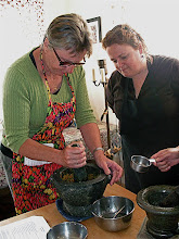 Photo: Judy pounding ingredients to make marinade for satay while Jeanne looks on