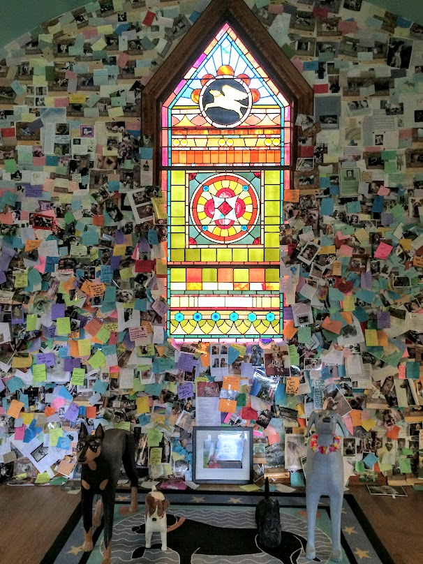 Inside the chapel. This guy went all out. Stain glass windows and all. The notes stuck to the wall are all from pet owners that have lost a pet at some point in time.