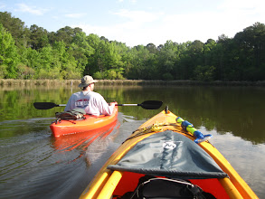 Photo: Helpdesk and Cap'n Dan paddling the smooth waters of Lake Wateree