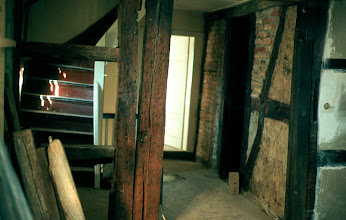 Photo: On the first floor, a little hallway connecting two big rooms and the bathroom in the middle - doorway on the right.
