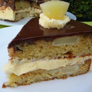Sponge Cake with Orange Flavored Whipped Cream and Chocolate Ganache.