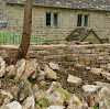 Dry stone wall, level coursing, during rebuild