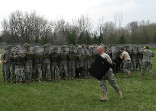 Photo: Staff Sgt. John Indrehus cirdles around for another attack on the riot-control formation during a civil disturbance exercise the 34th Military Police Company conducted with the Stillwater Police Department Apr. 22 in Stillwater, Minn.