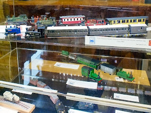 Photo: 003 A closer look at the top and middle shelves of the display case, (which I consistently fail at taking photos through glass with) featuring models by Tim Sanderson, Simon Wilson and Ted Polet .
