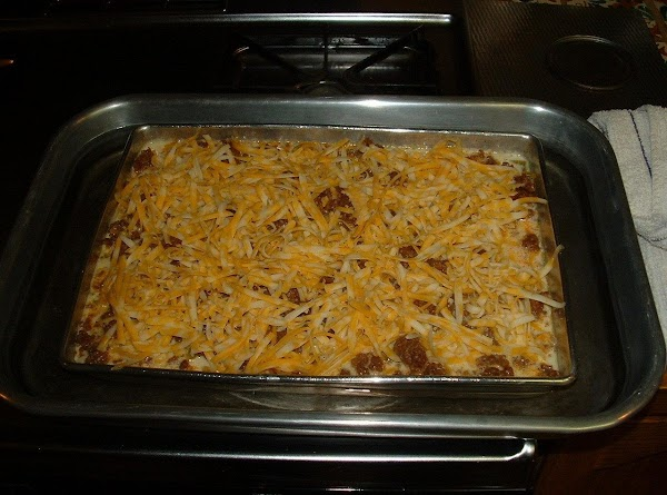 Open the oven and pull out the rack. Place your larger pan on the...