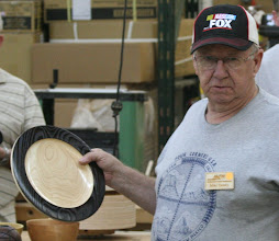 Photo: Mike talks about his ash plate with pyrography on the rim.