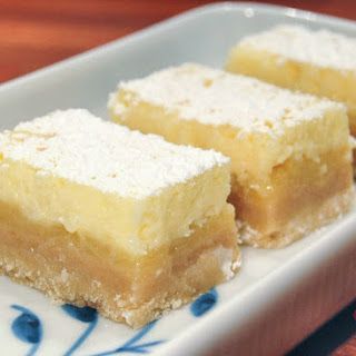 Zesty Lemon Bars With Cheesecake Topping