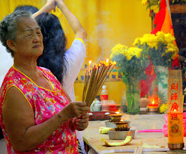 Photo: Year 2 Day 108 - A Woman Lighting Incense for the Emperors