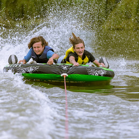 Hold Tight by Gary Pore - Uncategorized All Uncategorized ( watersports, splash, boys, fun, boat, float, river )