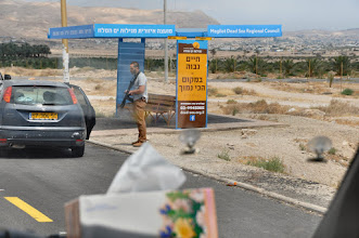 Photo: A Jewish settler is checking a car.