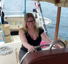 Photo: Captain Leigh at the helm