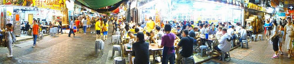 Photo: Panoramic photo of street food cafes Kowloon, Hong Kong.