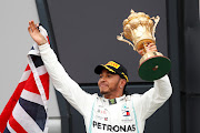 Mercedes' Lewis Hamilton with the trophy as he celebrates winning the race on the podium at Silverstone Circuit in Silverstone, England on July 14 2019.