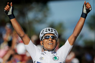 Photo: Nairo Alexander Quintana of Colombia, wearing the best young rider's white jersey, crosses the finish line to win the 20th stage of the Tour de France cycling race over 125 kilometers (78.1 miles) with start in in Annecy and finish in Annecy-Semnoz, France, Saturday July 20 2013. (AP Photo/Peter Dejong) APTOPIX Cycling Tour de France