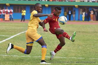 Photo: Ernest SUGIRA (16) challenging John Boye (4)[Rwanda Vs Ghana AFCON2017 Qualifier, 5 Sep 2015 in Kigali, Rwanda.  Photo © Darren McKinstry 2015