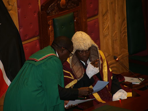 National Assembly speaker Justin Muturi (R) confers with an official during a session on August 21, 2017. /HEZRON NJOROGE