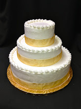 Photo: Smooth wedding cake w/gold ribbon wrap & traditional borders around tops.