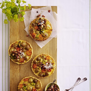 Potato Tartlets with Bacon and Hazelnut Topping