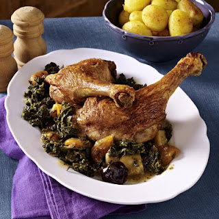 Roast Duck with Fried Potatoes and Kale.