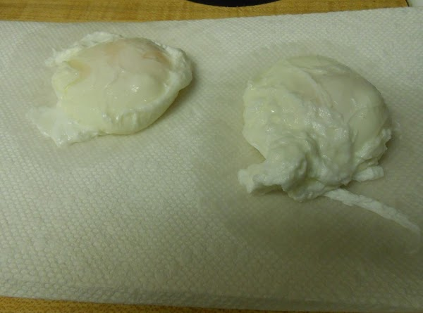 Remove eggs from pan with a slotted spoon and drain on paper towels while...