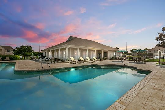 Laurel Park apartment swimming pool at dusk