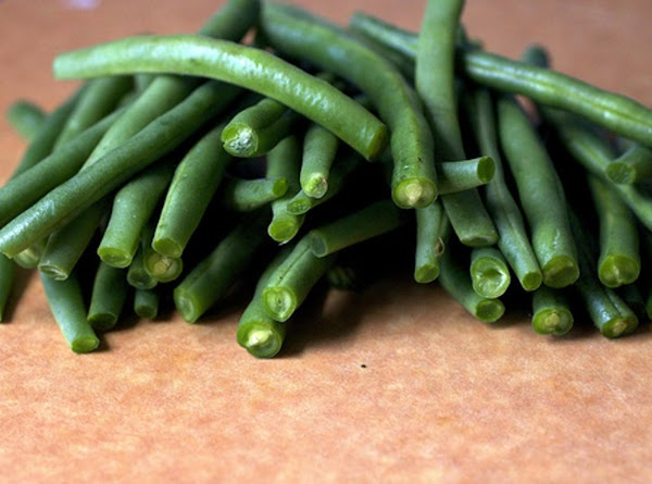 Boil the green beans in salted water for 2-3 minutes. Remove and put in...
