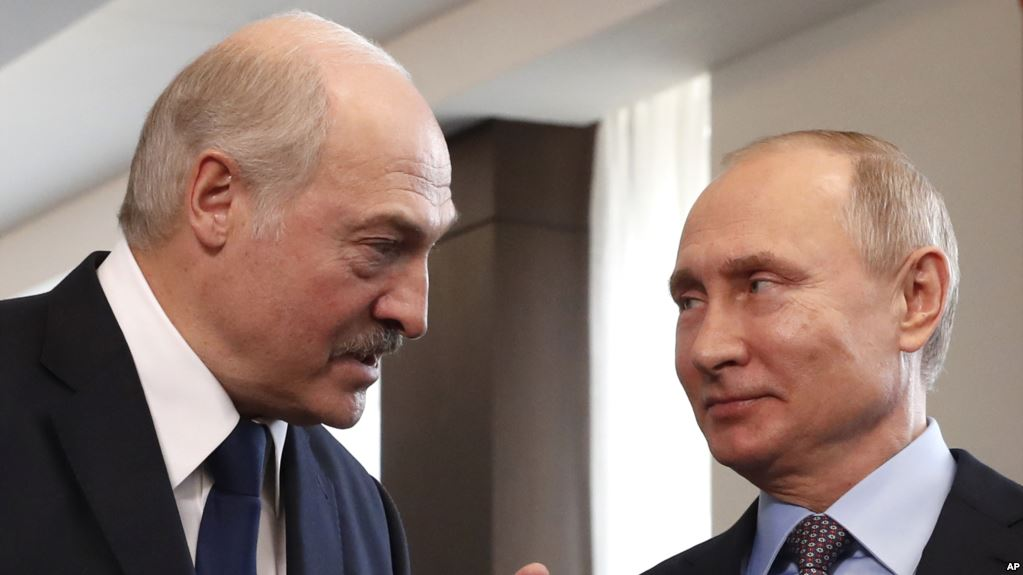 FILE - Belarusian President Alexander Lukashenko (L) speaks to Russian President Vladimir Putin during their meeting at the Sirius educational center in the Black sea resort of Sochi, Russia, Feb. 15, 2019.