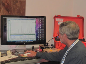 Photo: The master at work, analyzing data samples. And showing us a comparison of minerals to... Tylenol, LOL!