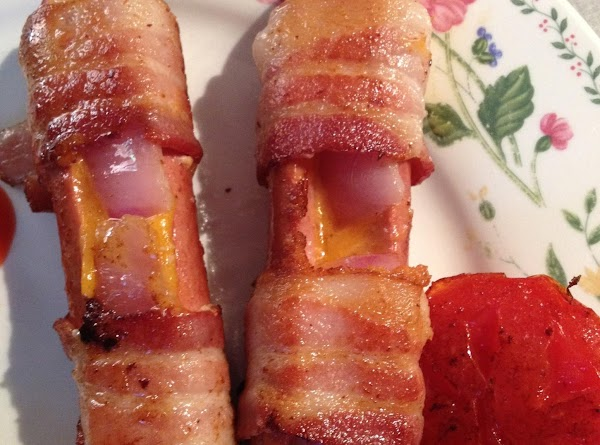 Open each hot dog, put slices of cheese in the slit. If using the...