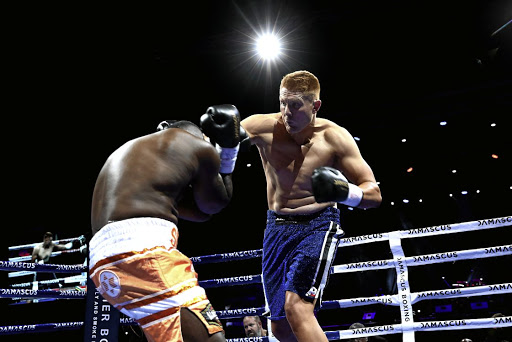 Ruann Visser lands a punch on Justice Silinga during their SA and WBA Pan African heavyweight bout at Sun Arena in Pretoria. /Masi Losi