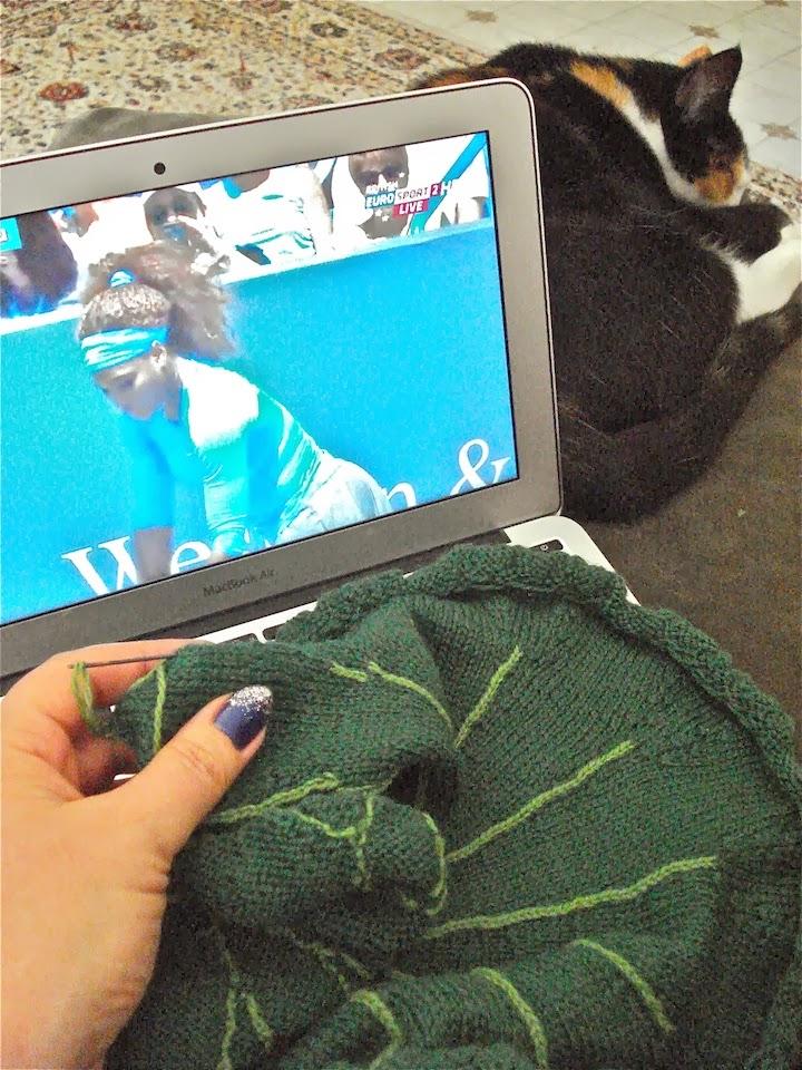 Photo: My perfect trifecta, knitting, cat, tennis! Photo credit: Ruth Marshall.