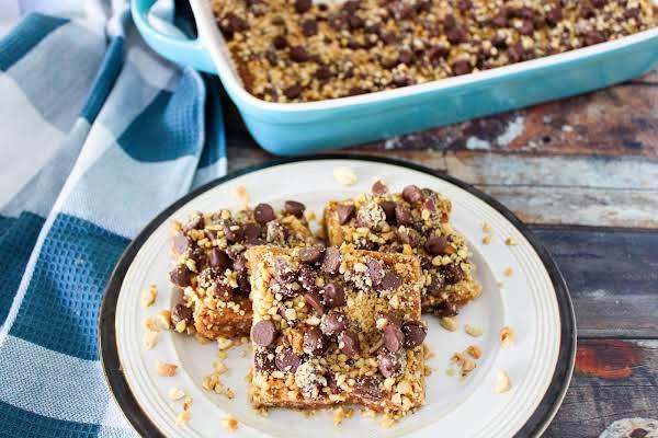 Three Peanut Squares (peanut Brittle Cookies) On A Plate.