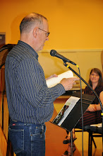 Photo: Michael Heavener reads his contribution to the anthology.