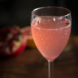"""Old Fashioned GF Experience"" fresh grapefruit pomegranate prosecco cocktail."