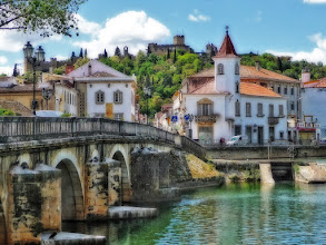Photo: A view of Tomar, Portugal This is a quaint village in Portugal, where the Convent of Christ (seen in the back at the top of the hill), a templar church, was built. I softened the hard contrasts of midday light using the orton effect. (feel free to reshare!)