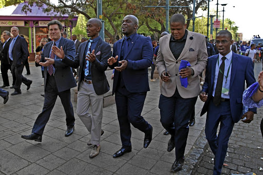Mayor Solly Msimanga and his entourage walking to the council chamber of the City of Tshwane where he faced a motion of no confidence. / Thapelo Morebudi.
